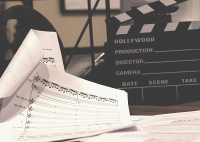 Sheet Music and Clapperboard